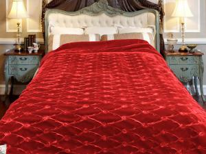 Red embroidered blanket